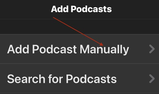 Screenshot of a red arrow pointing toward the Add Podcast Manually link within Downcast